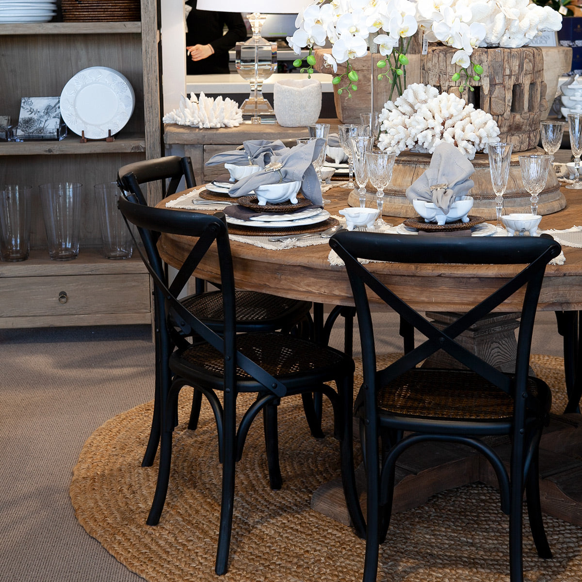 Old elm round dining table with coastal plates.