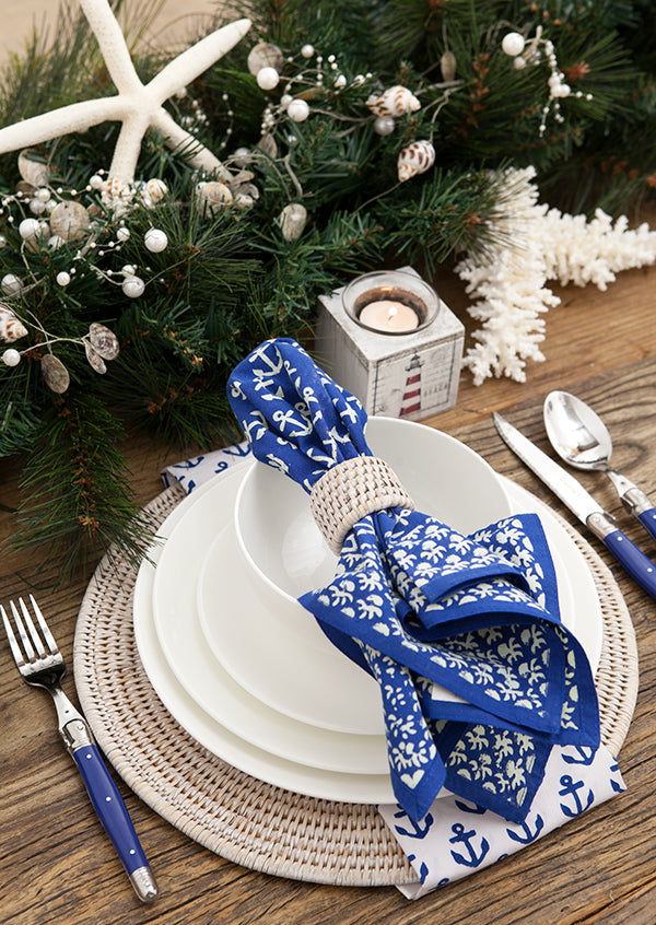 White plates, rattan and navy anchor napkins.