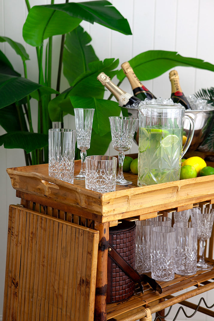 Outdoor crystal vases on bamboo cart.