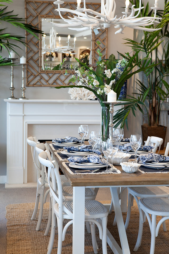Dining table styled with blue & white.