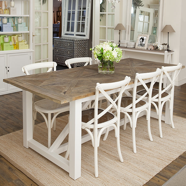 Elm top dining table with white timber base.