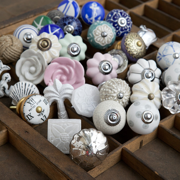 Drawer knobs grouped together in a tray.