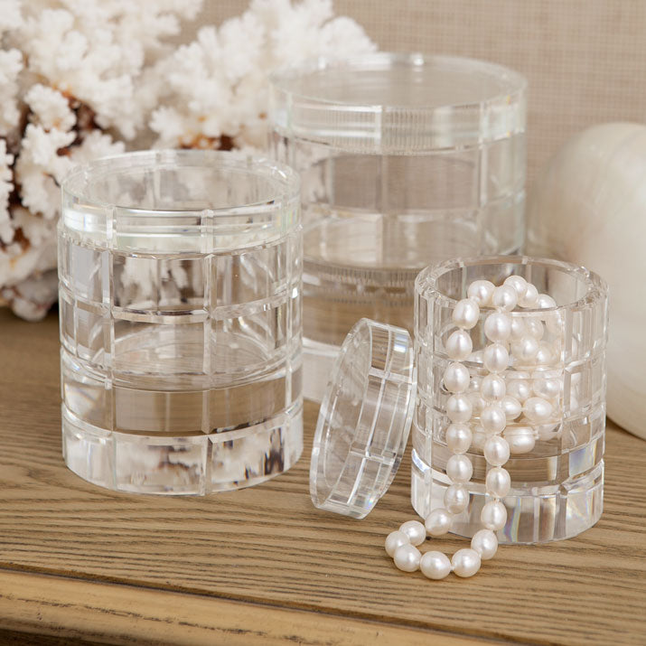 Etch glass boxes displayed with pearls.