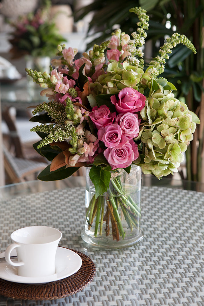 A bouquet of pink roses with green foliage.