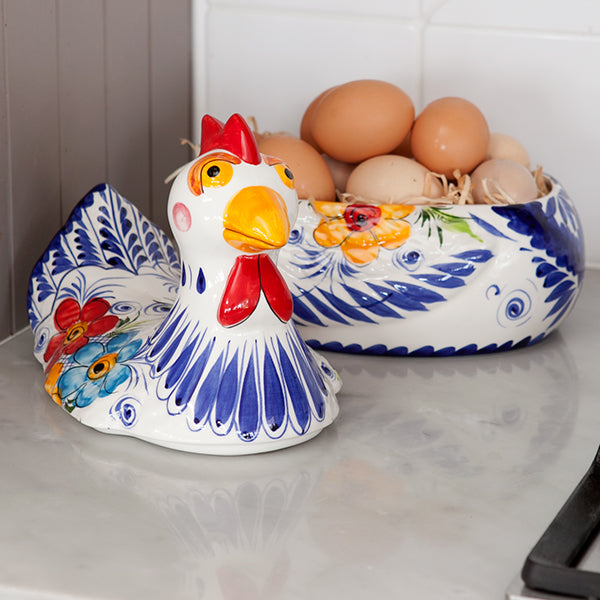 A rooster bowl with eggs in.