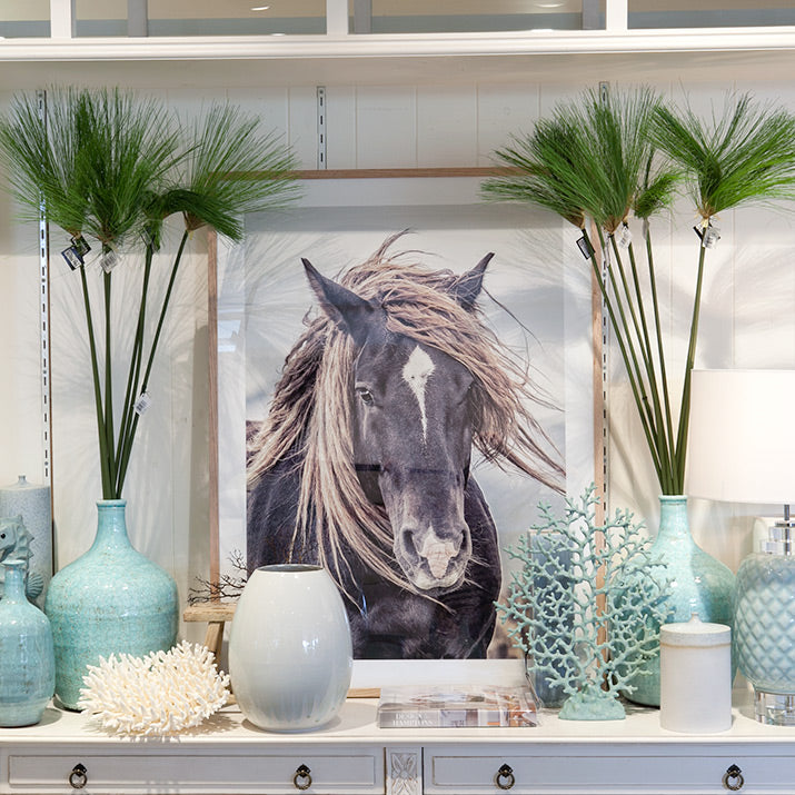 India Hicks book with carved horse.