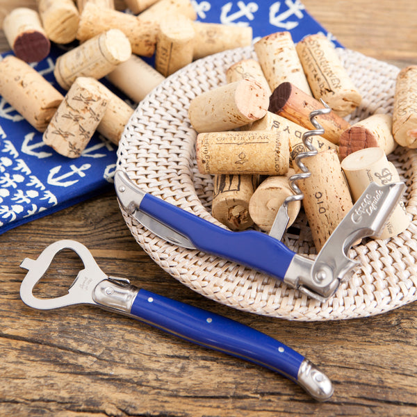 Two blue handled bottle openers with corks.