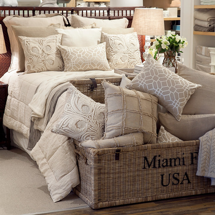 Layered bedding with plenty of cushions.