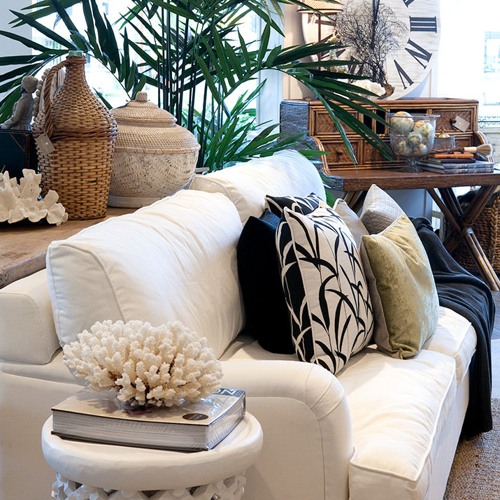White Nantucket Lounge with black and white cushions.