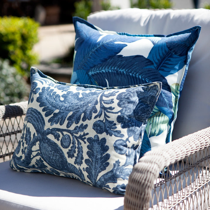 Blue and white outdoor cushions on armchair.