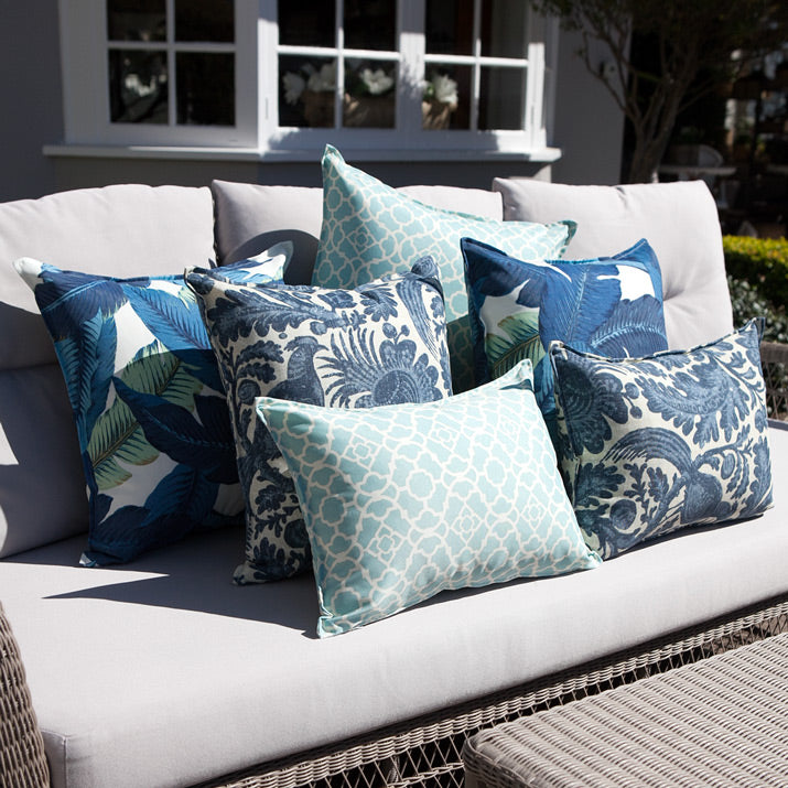 Blue, white & aqua outdoor cushions on lounge.
