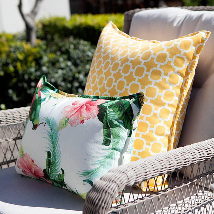 Tropical style outdoor cushions on armchair.