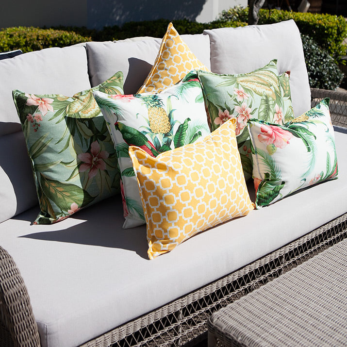 Lounge with tropical yellow and green outdoor cushions.