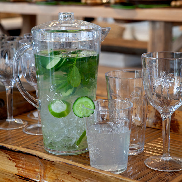 Outdoor palm tree glasses and jug.