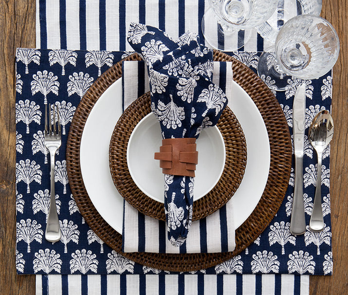 Top view of palm napery table setting.