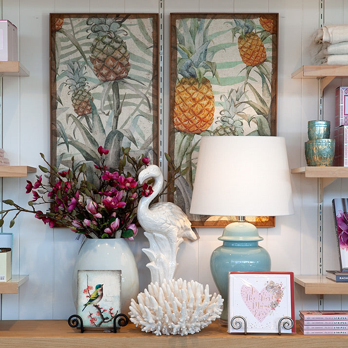 Pineapple prints with aqua lamp.