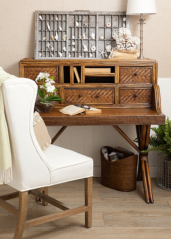 Brown Rattan Desk with white Carver chair.