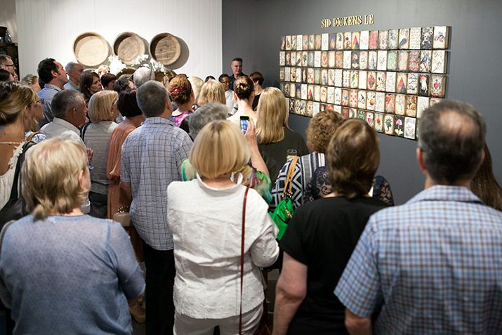 A large crowd in front of the Limited Edition wall.