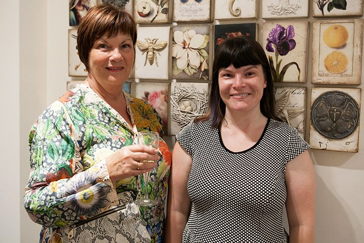 Mother and daughter in front of Sid Dickens Memory Blocks.