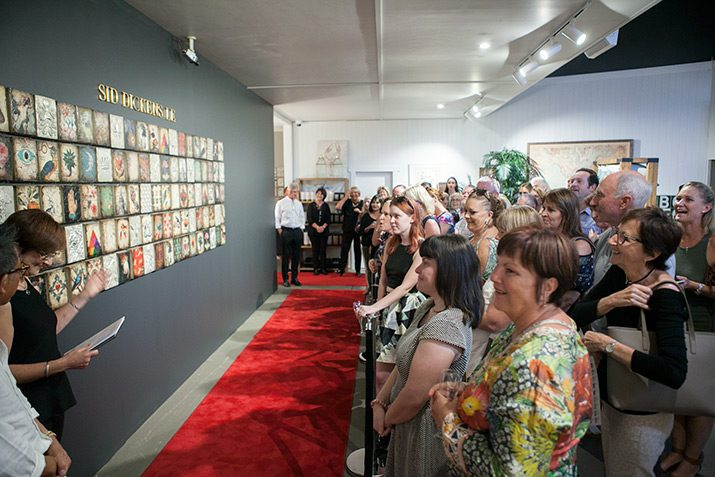 A crowd in front of the Sid Dickens Limited Edition Collection.