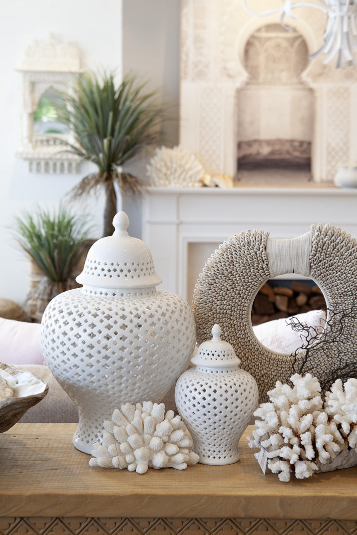 White temple jars on carved timber console.