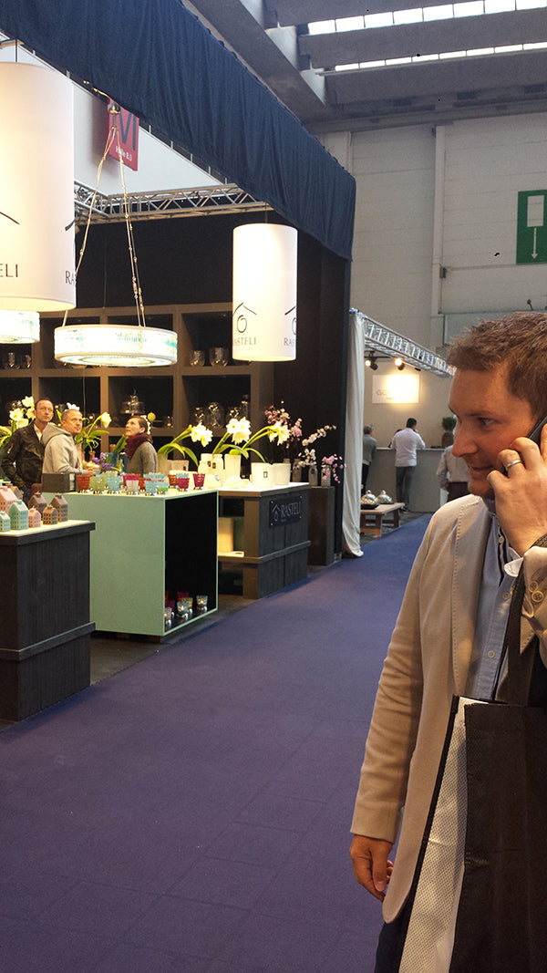 Michael on the phone at the tradefair.