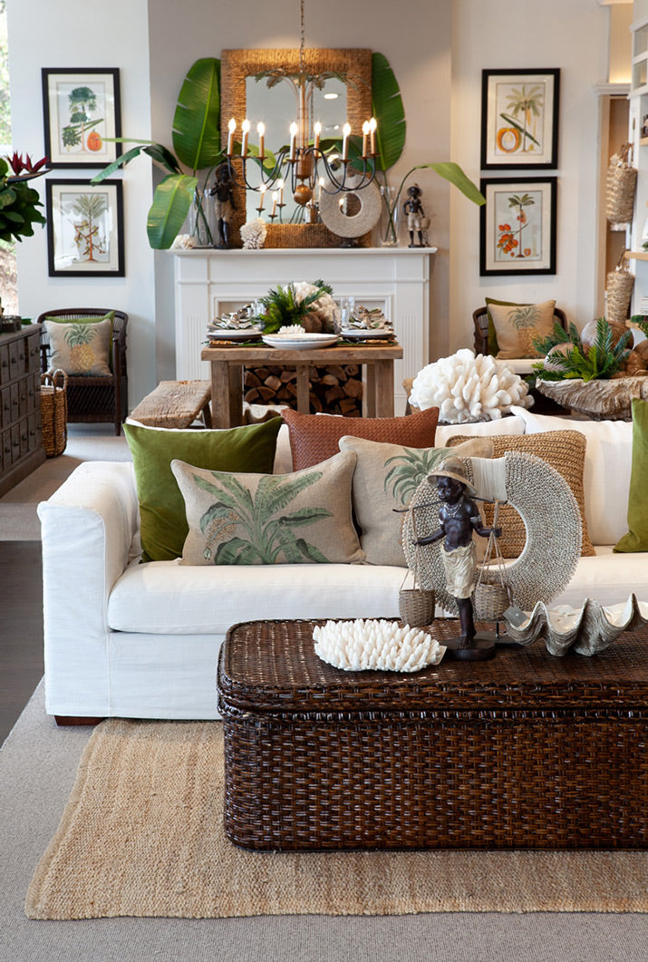 Tropical living room with brown rattan coffee table.