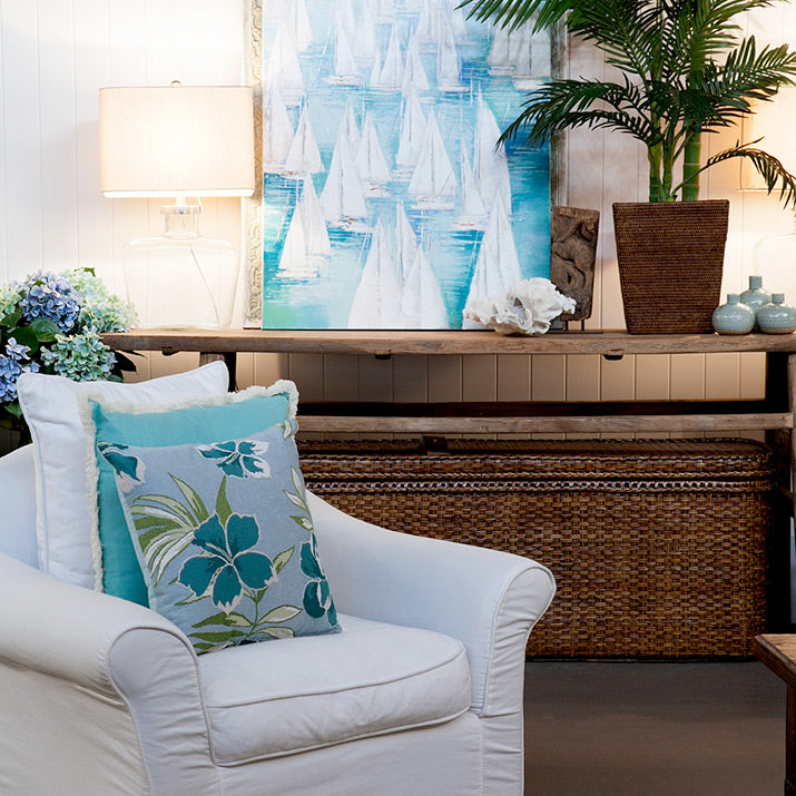 Turquoise painting with matching cushions.