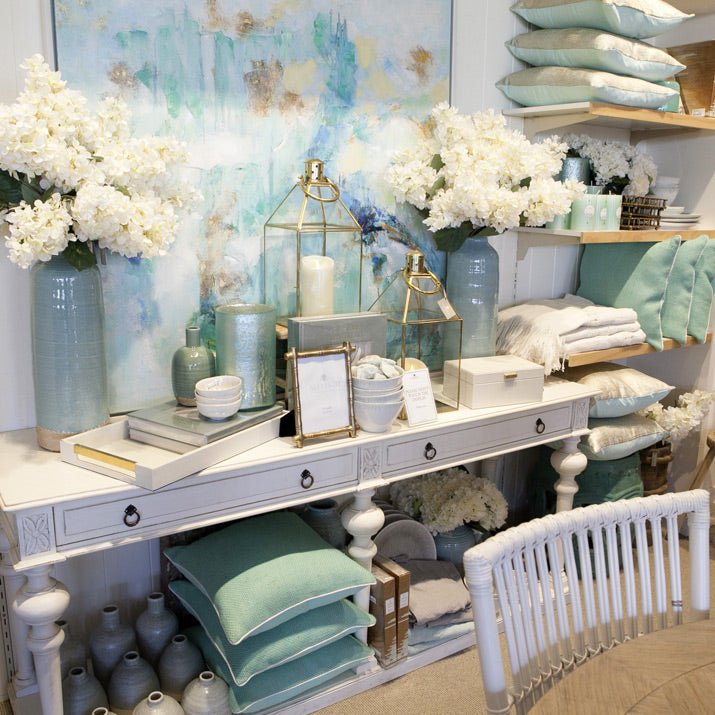 Turquoise cushions and artwork.