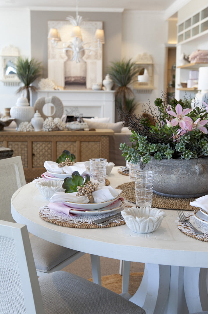 Round white table with succulent centrepiece.