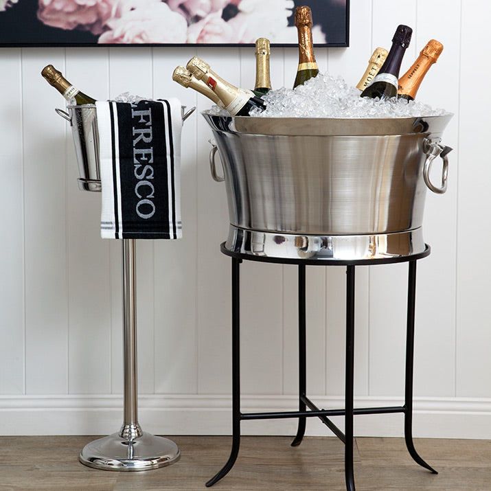 Metal wine buckets on stands.