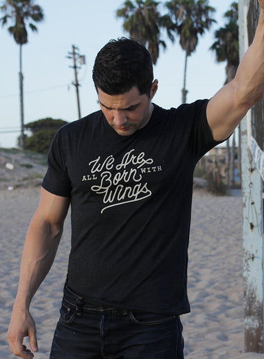 """We Are All Born With Wings"" short sleeve vintage black t-shirt"