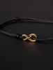 Infinity Bracelet - Black cord men's bracelet with gold clasp