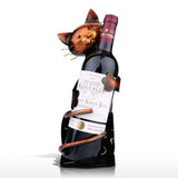 the metal cat wine bottle holder holding a bottle of wine