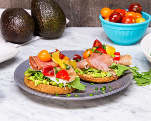 keto-friendly avocado toast with prosciutto and arugula