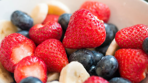 Strawberry and blueberry fruit salad with protein powder.