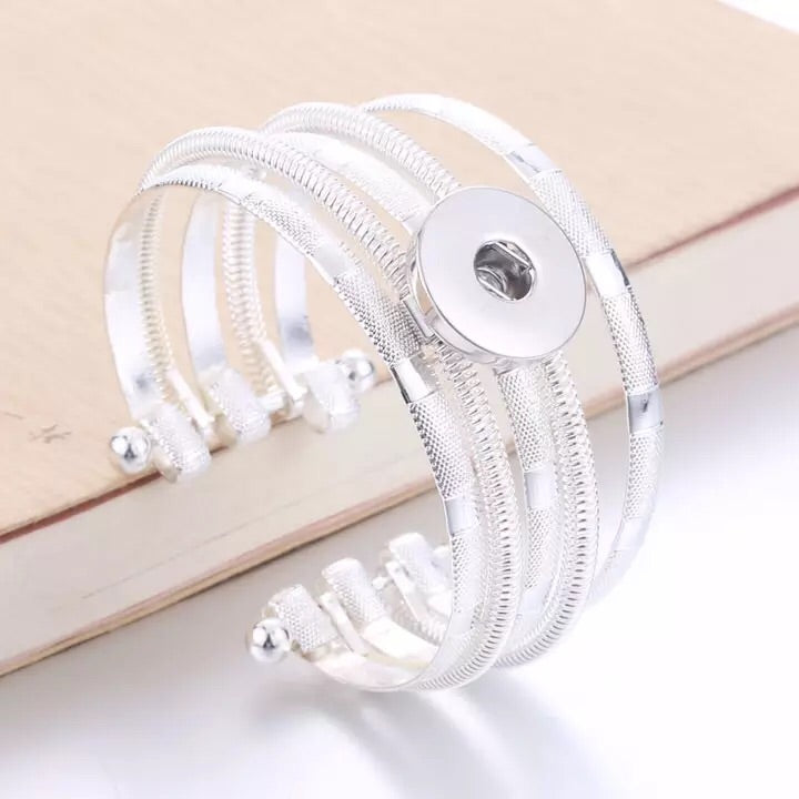 Multi Bangle Snap Jewelry Bracelet. Comes with a free snap of your choice.