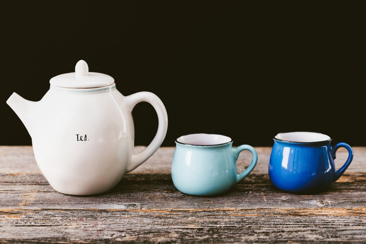 Teapot with Two Blue Teacups - Uniting Our Tea Community - The Cove Tea Company - Edmonton, Alberta Canada