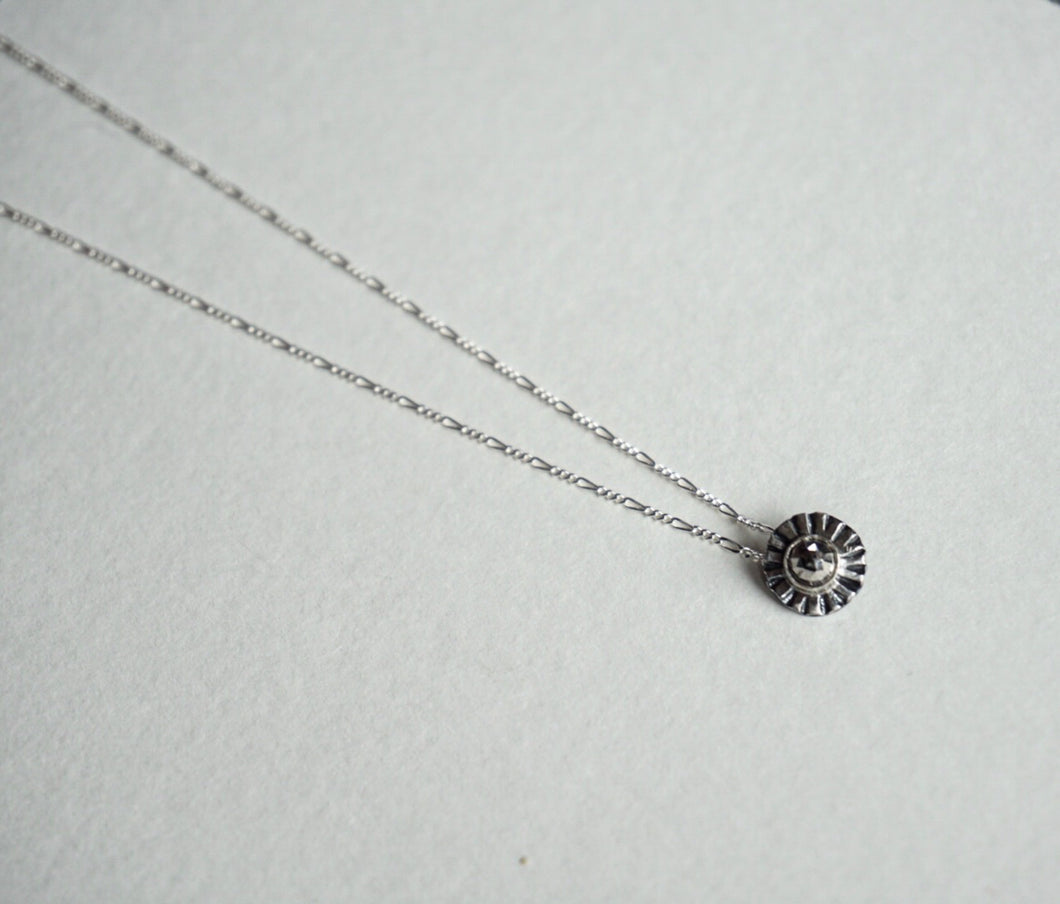 Small sterling silver ridge circle necklace with faceted pyrite