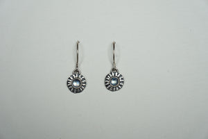 Small silver ridged circle drop earring with moonstone