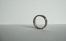 Load image into Gallery viewer, Sterling silver ring with texture on all sides size 6.5