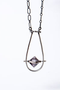 Silver spinning flourite pendant