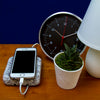 Cord Valet Granite Cord Organizer with Cords on Bedside Table