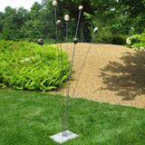 Cattail Sculpture made of Beach Stones, Stainless Steel, and Granite outdoors