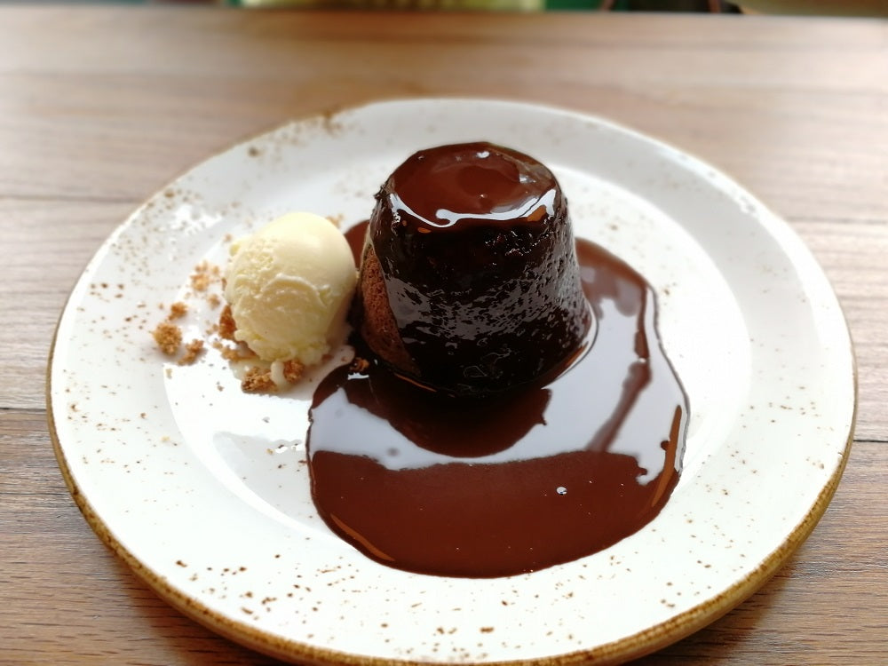 Chocolate pudding with homemade vanilla ice cream
