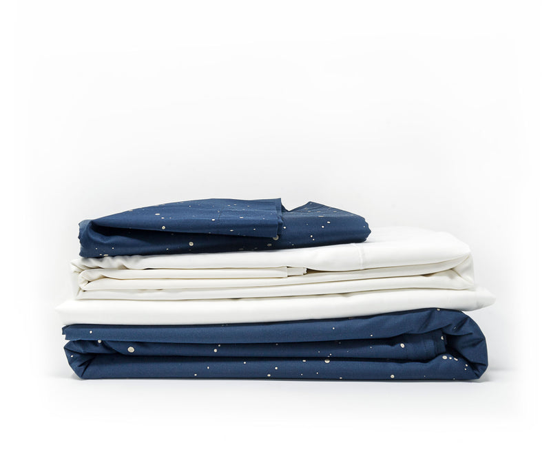 luxe navy blue sheets contrasting with white flat sheet and fitted sheet