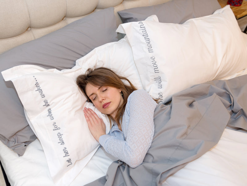Woman sleeping on embroidered pillow cases