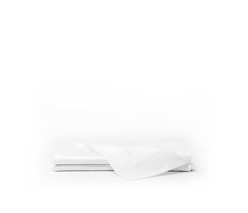 Sateen pillow shams with white cording