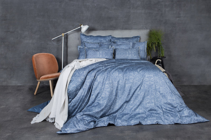 Bedroom accent wall design complementing the blue sateen sheets set