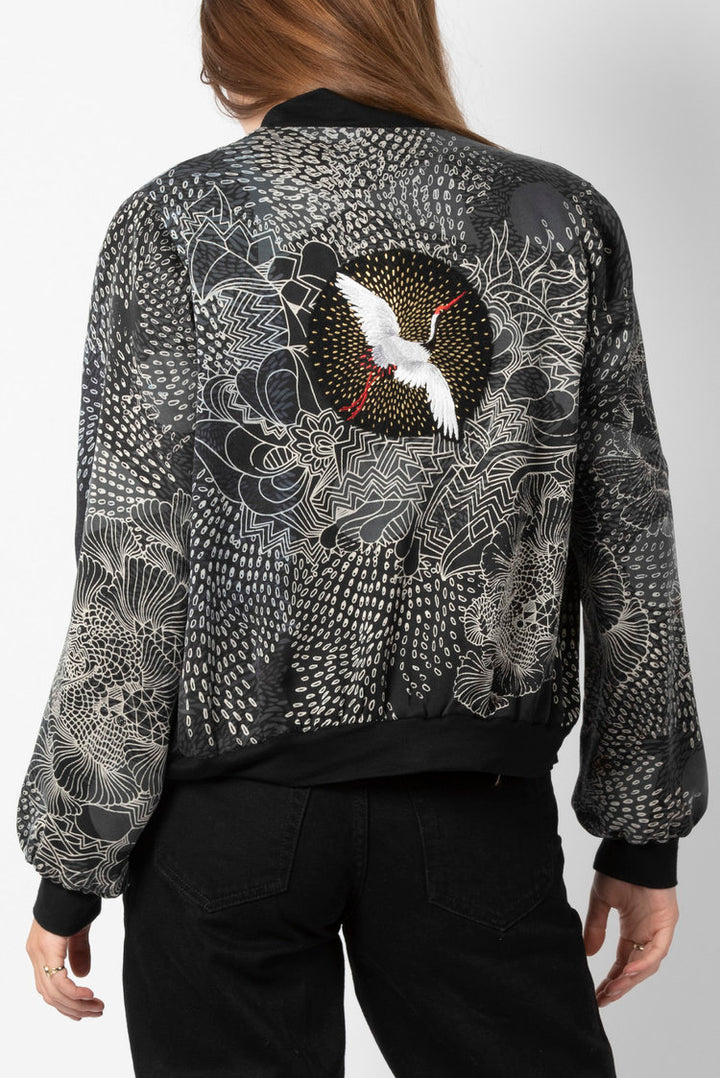 Silk bomber jacket in grey black and white with an embroidered bird on rear